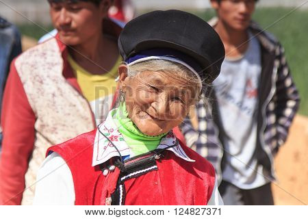 Heqing, China - March 15, 2016: Chinese Woman Dressed With Traditional Bai Clothing During The Heqin