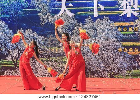Heqing, China - March 15, 2016: Chinese Women Dressed With Traditional Clothing Dancing And Singing