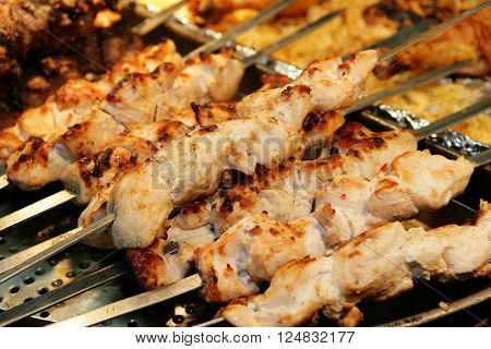 Closeup of skewers of chicken meat on skewers