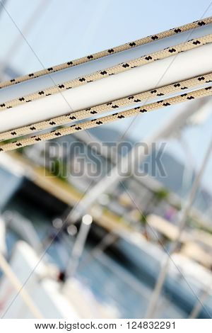 Details of the mast with ropes. Yacht marina