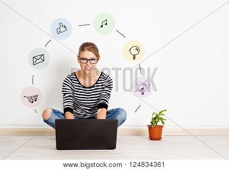 Pretty female with computer sitting at home with icons around. Concept of internet marketing and media.