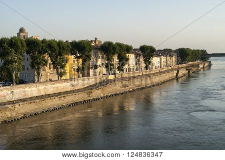 Arles (Bouches-du-Rhone Provence-Alpes-Cote-d'Azur France): cityscape along the river at evenng