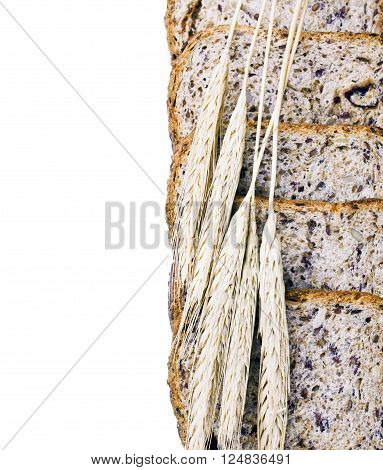 ears of wheat are on the bread and place for text