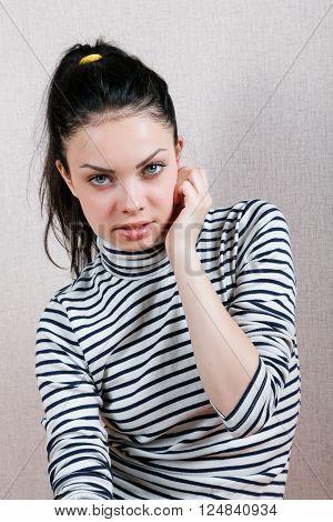 Portrait Of A Sad Girl In The Interior