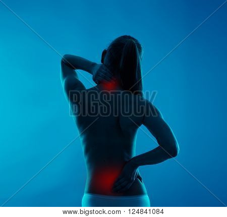 Backache on female body. Young woman touching her neck and loin in pain.