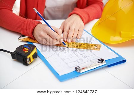 Woman engineer sketching draft. Young female professional designer working on new architectural project.