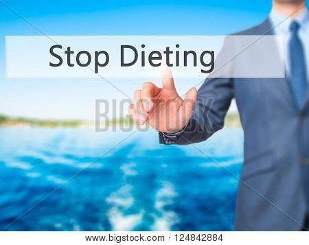 Stop Dieting - Businessman Hand Pressing Button On Touch Screen Interface.
