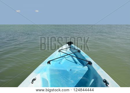 blue kayak floating in the ocean vacation concept