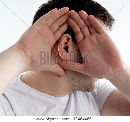 Closeup of man ear. Male suffering from deafness.