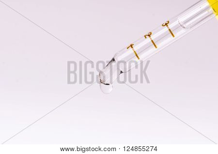 Dropper on a white  background. Equipment for chemical at the laboratory isolated. Medicine, aromatherapy. Dropping pipet.