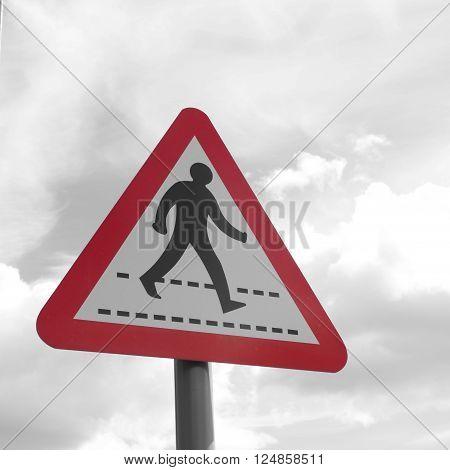Red triangular sign warning of a zebra (pedestrian) crossing