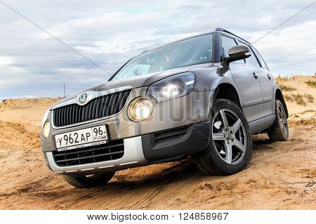 NOVYY URENGOY, RUSSIA - SEPTEMBER 5, 2015: Motor car Skoda Yeti at the countryside.