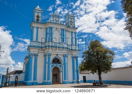The blue colonial Santa Lucia church in San Cristobal de las Casas Chiapas Mexico.