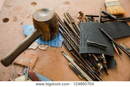 Various kinds of Sculpting Tools laying down on dirty wooden table