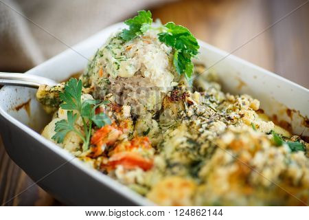 meatballs baked with vegetables in ceramic form