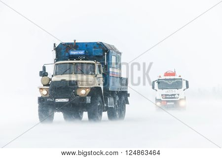 NOVYY URENGOY RUSSIA - MARCH 20 2016: Truck Ural 4320 at the interurban freeway during a heavy northern blizzard.