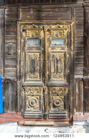Carved wooden door of an old house, Russia