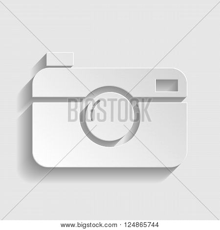 Digital photo camera icon. Paper style icon with shadow on gray.