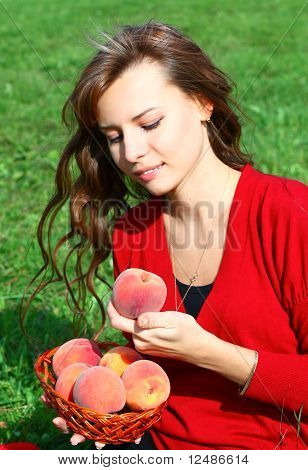 Beautiful Girl With fruit in summer green park
