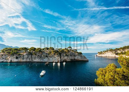 White Yachts boats in bay. Calanques - a deep bay surrounded by high cliffs in the azure coast of France