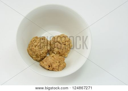 Peanut butter oatmeal cookies in white bowl