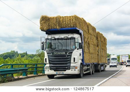 RHONE-ALPES, FRANCE - AUGUST 7, 2014: White hay carrier Scania R500 at the interurban freeway.
