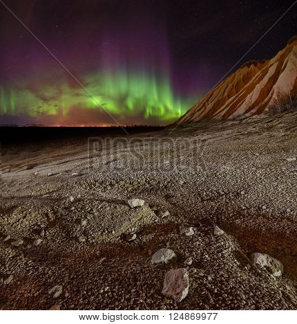 Panorama of Aurora polaris above mountains. Russia