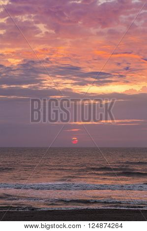 The sun rises over the Atlantic Ocean with moody pastel tones on a Florida beach. ** Note: Visible grain at 100%, best at smaller sizes