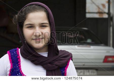 Portrait of Teenage Beautiful Girl Wearing Traditional Knitted Cloth with Shawl And Posed for Camera