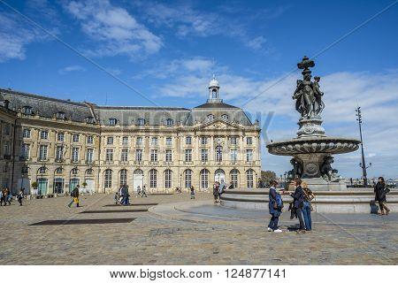 Bordeaux France - March 26 2016. People walking in Place de la Bourse square. Bordeaux Aquitaine. France.