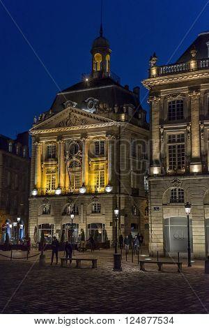 Bordeaux France - March 24 2016. People walking in Place de la Bourse square at night. Bordeaux Aquitaine. France.