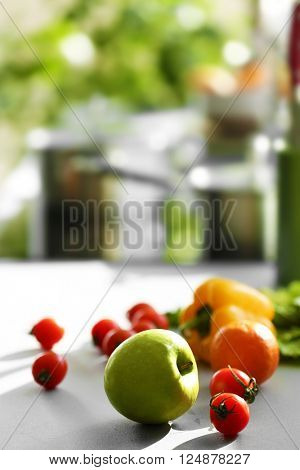 Fresh fruits and vegetables on white kitchen table, close up