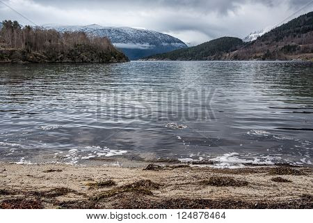 Small sand beach by a fjord in Norway