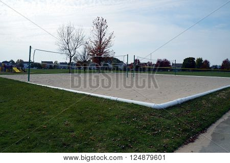 People may play volleyball in a neighborhood volleyball court in Joliet, Illinois.