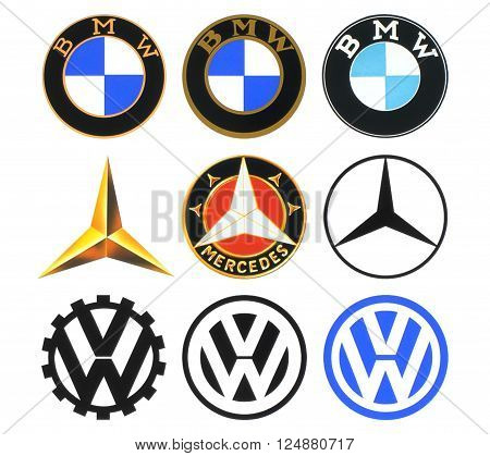 Kiev Ukraine - March 16 2016: Collection of retro car logos printed on white paper: Volkswagen BMW and Mercedes