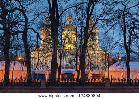 St. Nicholas Naval Cathedral behind the trees illuminated at night HDR St. Petersburg Russia