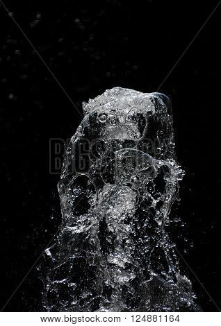 Fountain Water Stream And Drops Over Black