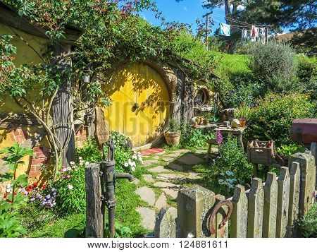 Hobbiton Film Set, New Zealand - March 31, 2015: A Hobbit home in The Shire from Lord of the Rings film set in Matamata