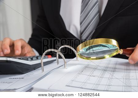 Young Businessman Checking Invoice