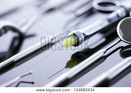 Professional dental equipment on table in pure steal light