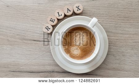 Closeup of coffee cup against wooden background