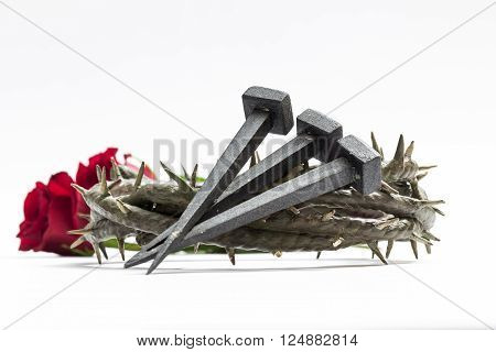 Jesus Christ crown of thorns, nails and two roses on a white background. ** Note: Visible grain at 100%, best at smaller sizes