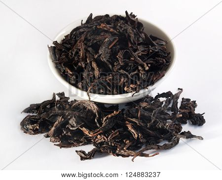 Chinese oolong tea Da Hong Pao Big Red Robe on white background