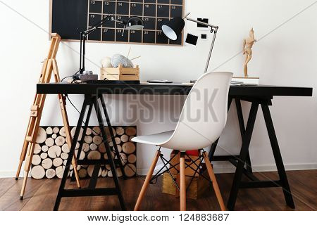 Desktop of creative person with different items indoors