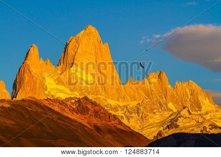 Fiery sunset illuminates the spectacular cliffs Fitz Roy. The stunning Patagonia