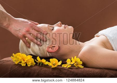 Young Woman Receiving Massage At Spa