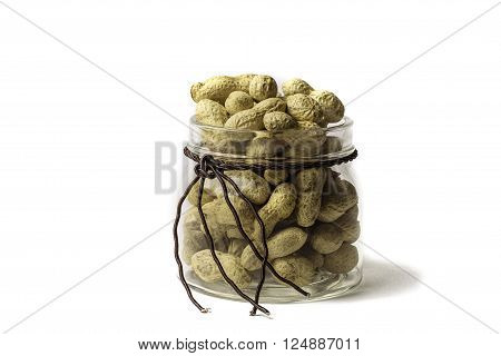 Peanuts in glass jar on white background. A whole jar of peanuts, isolate on white background. ?loseup