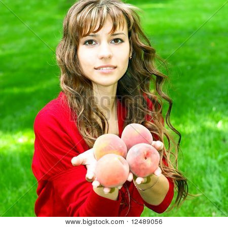 attractive young girl with sappy fruits outdoor