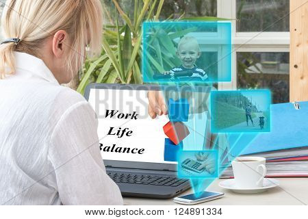 Blonde middle aged woman has open a laptop on the office desk. Smart phone is radiating transparent rectangles with a pictures of smiling blond boy woman inline skating and counting on calculator.