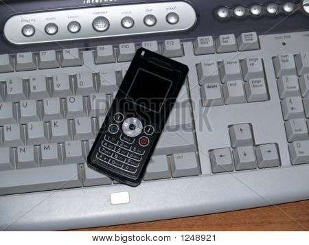 Cell Pone On Computer Keyboard